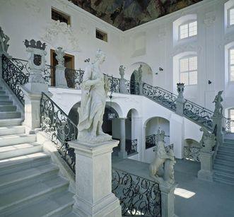 Staircase with richly decorated banisters, Meersburg New Palace. Image: Staatliche Schlösser und Gärten, Achim Weischer