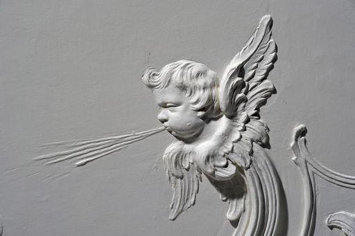 Cupid blowing air, late Rococo stucco in the audience chamber at Meersburg New Palace, by Carlo Pozzi, 1760/62. Image: Staatliche Schlösser und Gärten Baden-Württemberg, Arnim Weischer